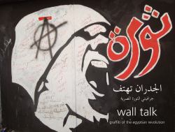 Al-Judran Tahtif : Jirafiti Al-Thawrah Al-Misriyah = Wall Talk: Graffiti of the Egyptian Revolution